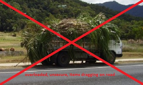 overloaded, unsecure, items dragging on road