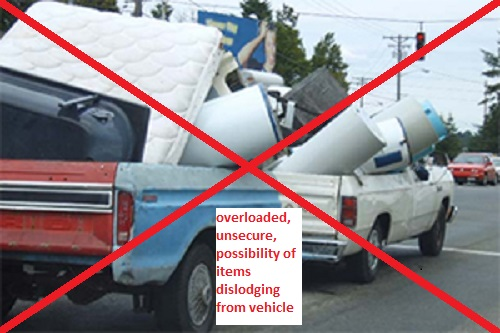 overloaded, unsecure, possibility of items dislodging from vehicle