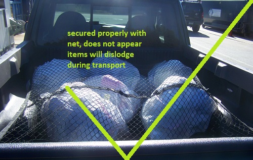secured properly with net, does not appear items will dislodge during transport